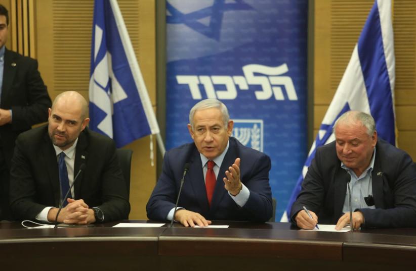 Prime Minister Benjamin Netanyahu and Likud members in December 24th, 2018 (photo credit: MARC ISRAEL SELLEM/THE JERUSALEM POST)