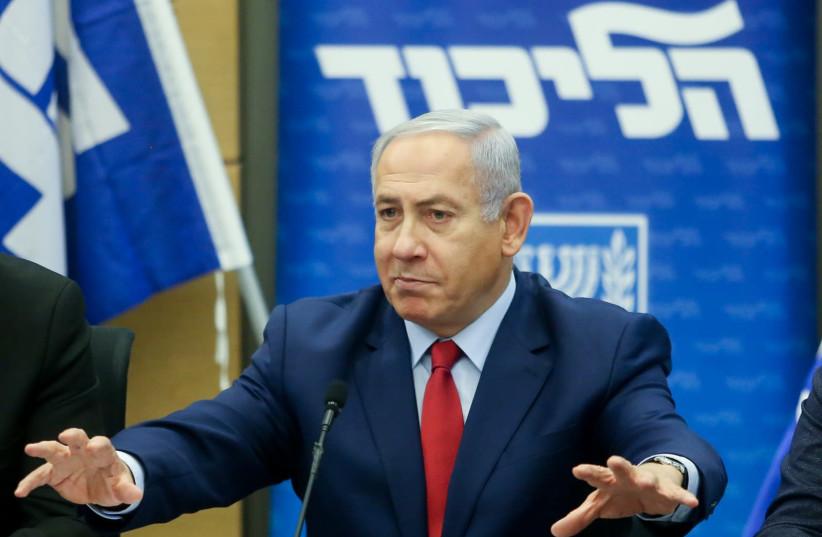 Netanyahu speaks at a coalition faction meeting (photo credit: MARC ISRAEL SELLEM)