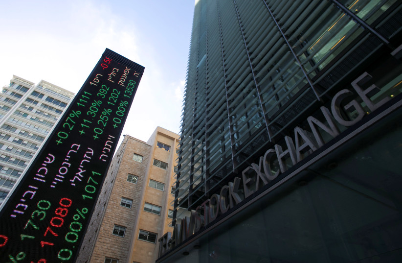 An electronic board displaying market data is seen at the entrance of the Tel Aviv Stock Exchange, in Tel Aviv, Israel January 29, 2017. (photo credit: BAZ RATNER/REUTERS)