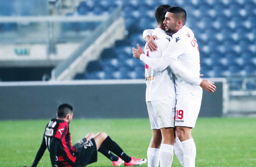 AFTER GOING down 1-0 to Hapoel Katamon, Hapoel Tel Aviv (in white) rallied back to claim a 2-1 road victory in State Cup action over the weekend (photo credit: DANNY MARON)