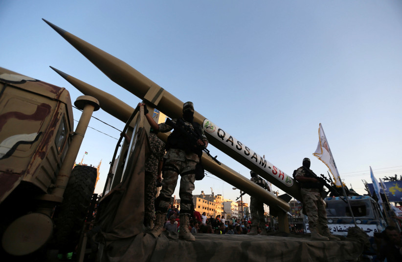 Palestinian members of al-Qassam Brigades, the armed wing of the Hamas movement, display home-made rockets during an anti-Israel military parade, in Rafah in the southern Gaza Strip August 21, 2016 (photo credit: IBRAHEEM ABU MUSTAFA/REUTERS)