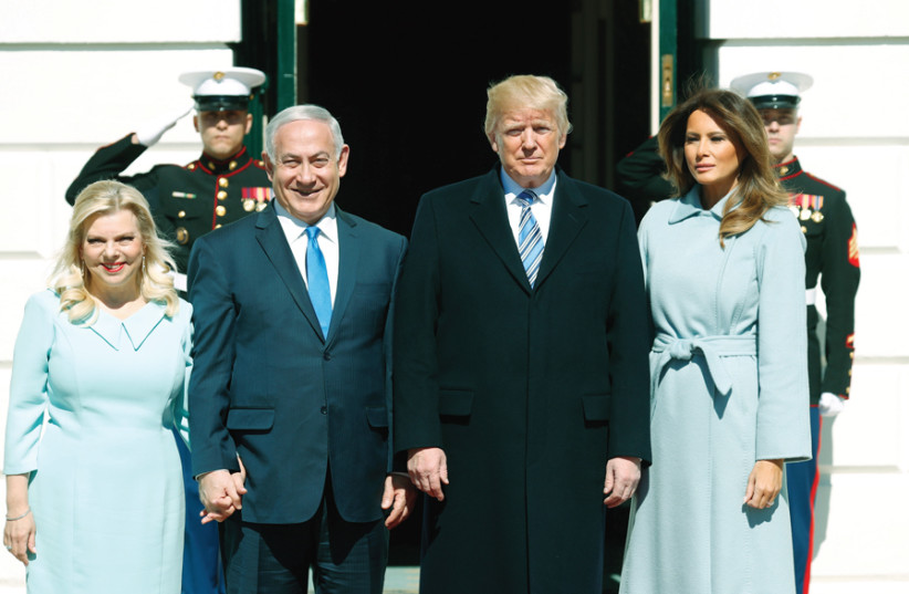 US PRESIDENT Donald Trump and First Lady Melania Trump welcome Prime Minister Benjamin Netanyahu and his wife Sara Netanyahu at the White House in Washington on March 5. (photo credit: REUTERS)