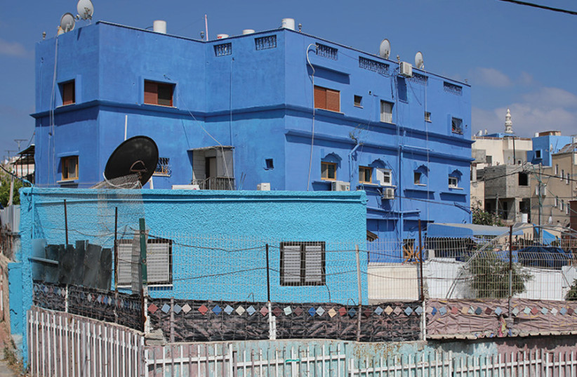 FEELING BLUE: Some of the houses that were painted thanks to Anat Cohen Halevi's initiative. (photo credit: ANAT COHEN HALEVI)