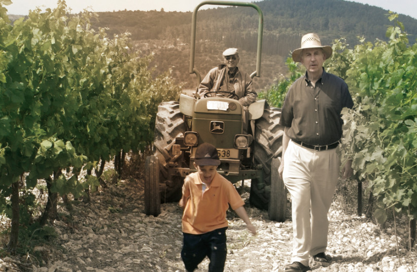 THE NEXT generation: Motti Shor walking the vineyard with his grandson. (photo credit: Courtesy)