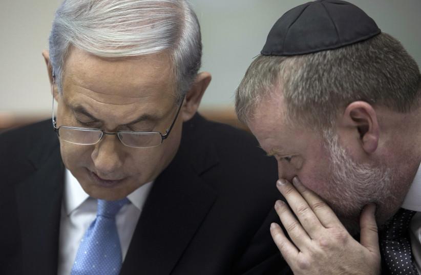 Israel's Prime Minister Benjamin Netanyahu listens to Avichai Mandelblit (photo credit: ABIR SULTAN/POOL/VIA REUTERS)
