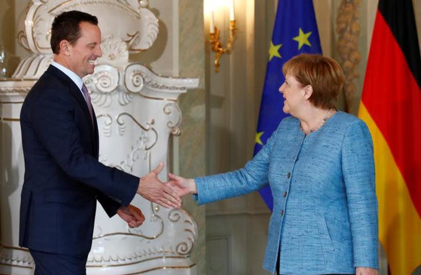 German Chancellor Angela Merkel receives the ambassador of U.S. to Germany, Richard Grenell, in Meseberg, Germany July 6, 2018. (photo credit: AXEL SCHMIDT/REUTERS)