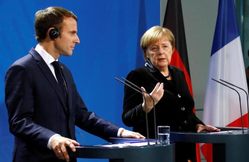 French President Emmanuel Macron and German Chancellor Angela Merkel speak to reporters ahead of their meeting in Berlin, Germany, November 18, 2018. (photo credit: REUTERS/FABRIZIO BENSCH)