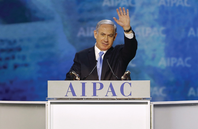 PRIME MINISTER Benjamin Netanyahu waves at the crowd at the AIPAC Policy Conference in 2015 (photo credit: REUTERS)