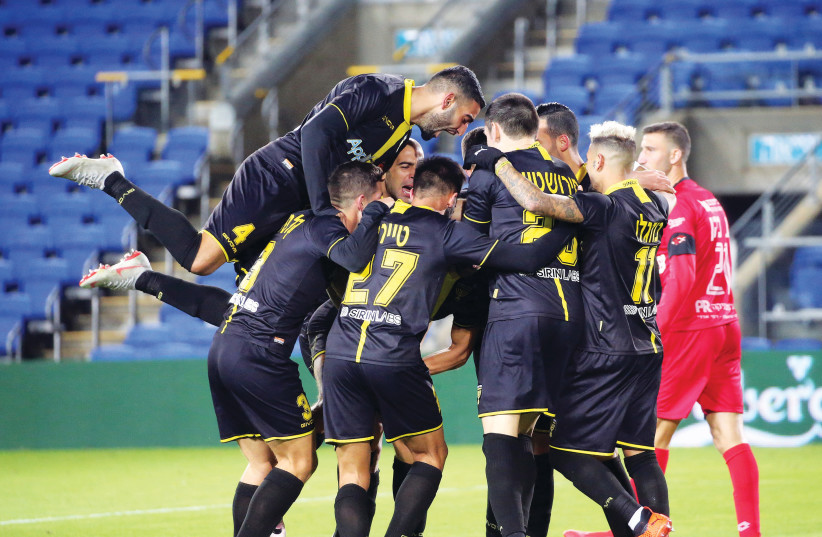 BEITAR JERUSALEM players celebrate their team's second goal in a 3-0 surprise road victory over Hapoel Hadera last night in Premier League action (photo credit: UDI ZITIAT)