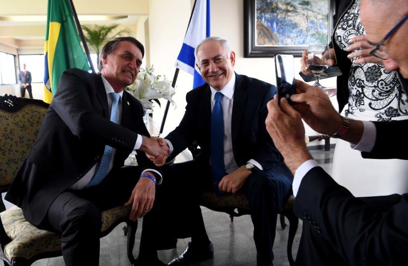 Prime Minister Benjamin Netanyahu and Brazilian President Jair Bolsonaro  (photo credit: AVI OHAYON - GPO)