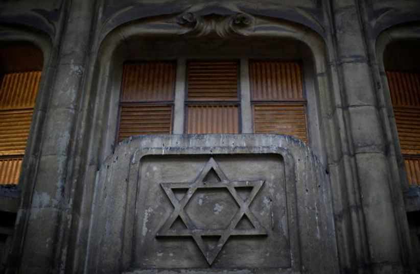 The Star of David is seen on the facade of a synagogue in Paris France, December 10, 2018. (photo credit: REUTERS/GONZALO FUENTES)