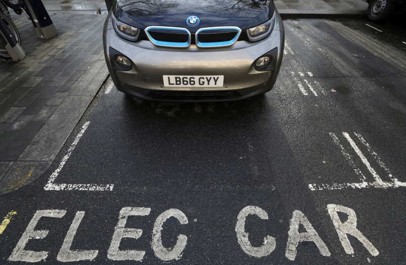A car is parked at a charging point for electric vehicles in London, Britain, March 6, 2018. (photo credit: REUTERS/SIMON DAWSON)