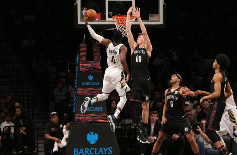 Indiana Pacers shooting guard Victor Oladipo (4) dunks against Brooklyn Nets small forward Rodions Kurucs (00) during the fourth quarter at Barclays Center, Brooklyn, NY, December 21st, 2018 (photo credit: BRAD PENNER/USA TODAY SPORTS VIA REUTERS)