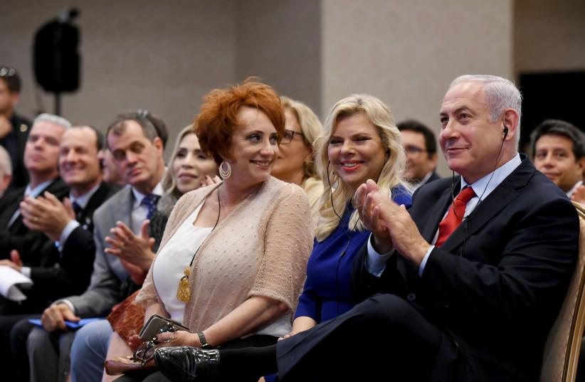 Prime Minister Benjamin Netanyahu and Sara Netanyahu meet with Christian friends of Israel in Rio de Janeiro, Brazil on December 30, 2018 (photo credit: AVI OHAYON - GPO)