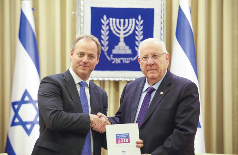 IDI President Yohanan Plesner presents the 2018 Democracy Index to President Reuven Rivlin (photo credit: NOAM MOSKOWITZ)