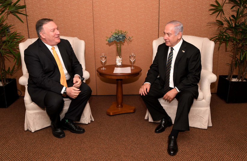 Prime Minister Benjamin Netanyahu [R] with US Secretary of state Mike Pompeo [L].  (photo credit: AVI OHAYON - GPO)
