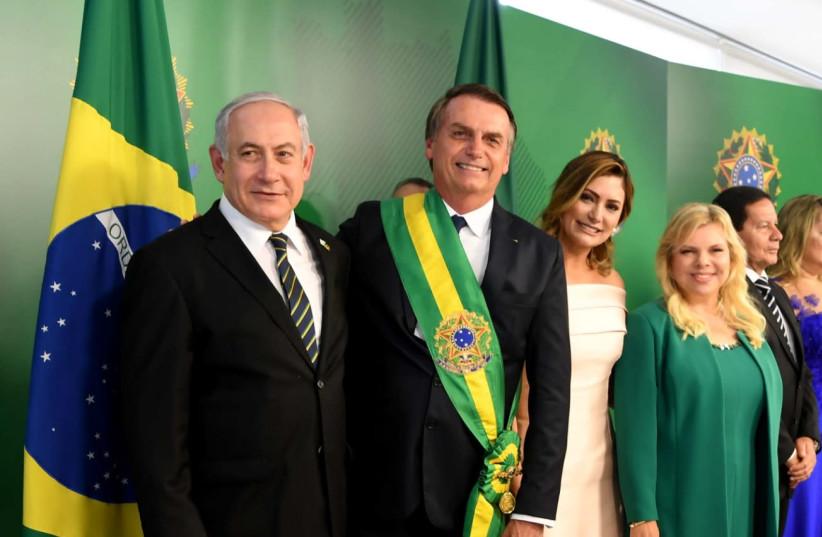 Prime Minister Benjamin Netanyahu with Brazilian President Jair Bolsonaro, his wife Michelle Bolsonaro, and the wife of the PM Sara Netanyahu   (photo credit: AVI OHAYON - GPO)