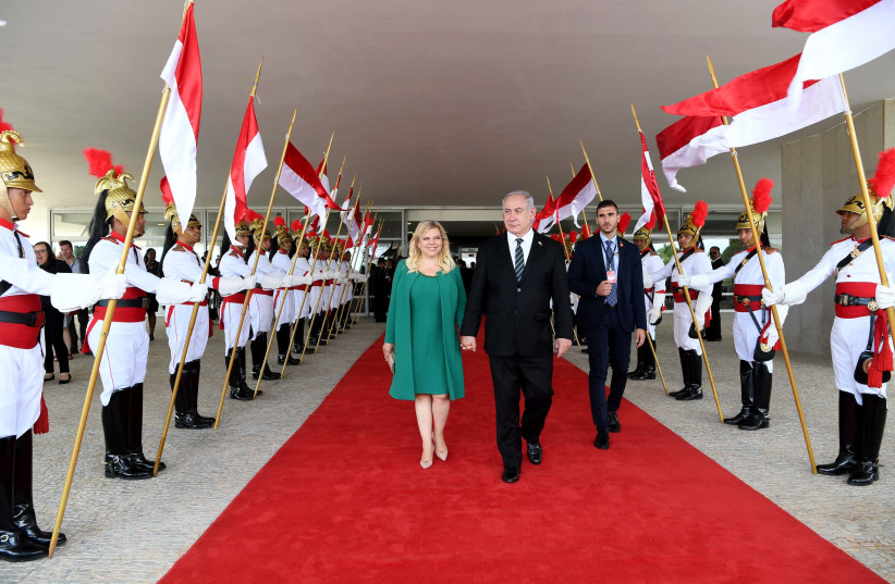 Prime Minister Benjamin Netanyahu and his wife Sara during a state visit to Brazil, December 2018 (photo credit: AVI OHAYON - GPO)