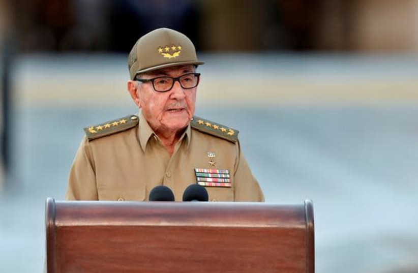 Cuban First Secretary of Communist Party Raul Castro Ruz gives a speech, on January 01, 2019, during the celebration of 60th Anniversary of Cuban Revolution at Santa Ifigenia Cemetery in Santiago de Cuba. At back, the Fidel Castro's tomb. (photo credit: REUTERS)