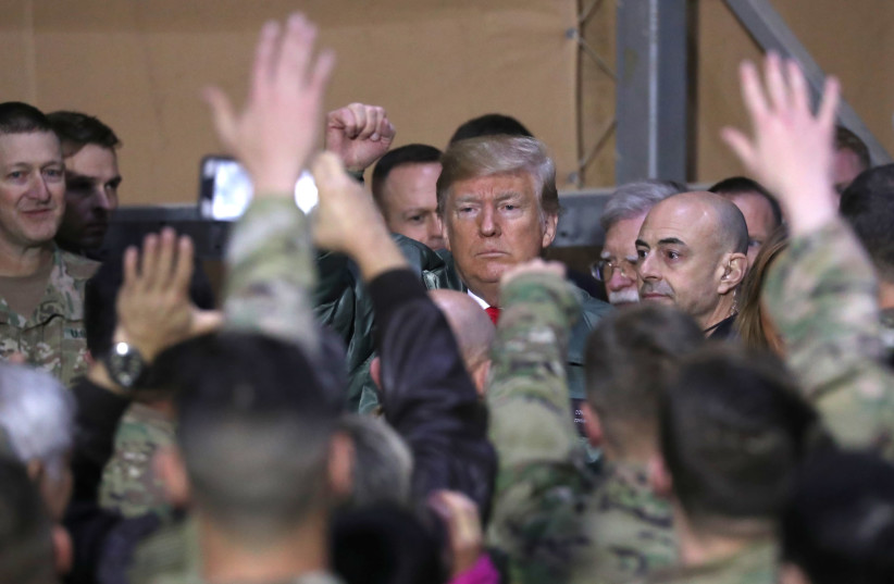 U.S. President Donald Trump delivers remarks to U.S. troops in an unannounced visit to Al Asad Air Base, Iraq December 26, 2018 (photo credit: JONATHAN ERNST / REUTERS)