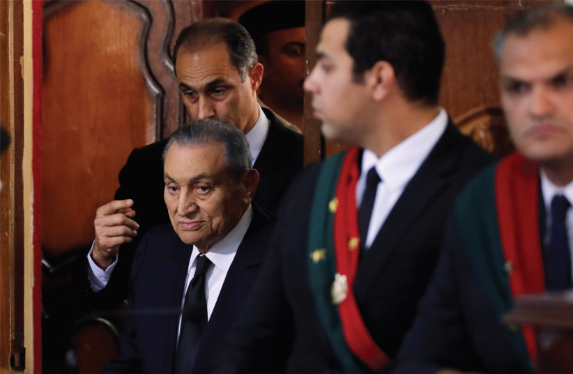 FORMER EGYPTIAN president Hosni Mubarak testifies during a court case accusing ousted Islamist president Mohamed Mursi of breaking out of prison in 2011, in Cairo on December 26. (photo credit: REUTERS)