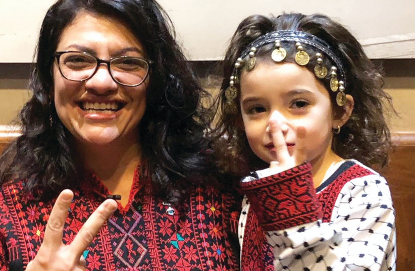 CONGRESSWOMAN RASHIDA TLAIB, the first Palestinian-American elected to the House, wears a traditional Palestinian robe at her swearing-in ceremony. (photo credit: REUTERS/ADAM SHAPIRO)