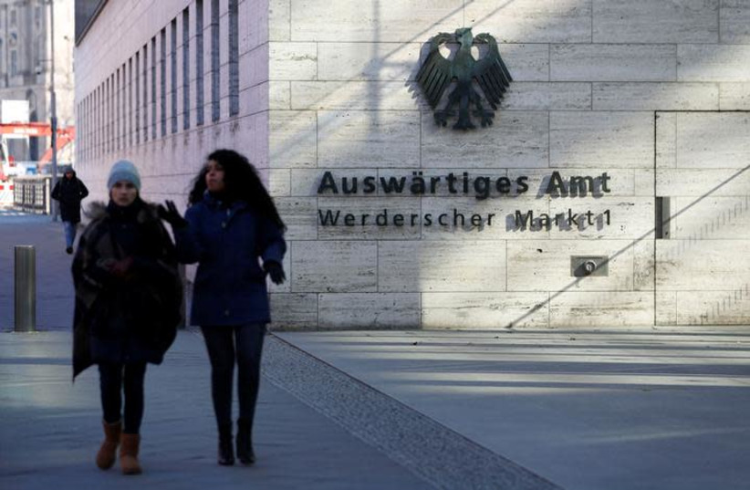 People walk past the seat of the German Foreign Ministry in Berlin, Germany, March 1, 2018. (photo credit: REUTERS/FABRIZIO BENSCH)