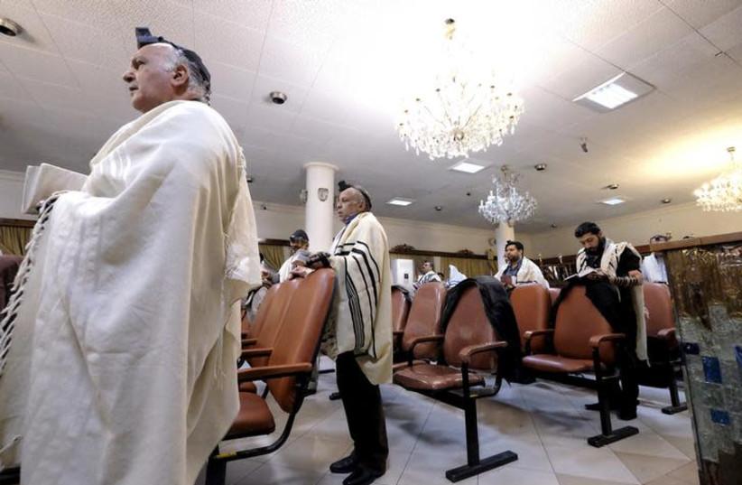 Iranian Jews pray at the Abrishami synagogue in Tehran, December 24, 2015 (photo credit: RAHEB HOMAVANDI/TIMA VIA REUTERS)