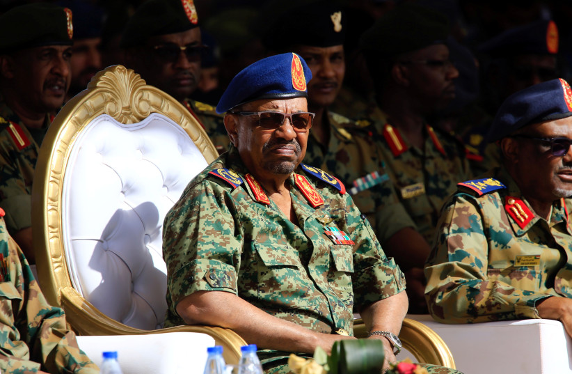 Sudan's President Omar Ahmed al-Bashir looks on during Sudan's Saudi Air Force show during the final training exercise between the Saudi Air Force and Sudanese Air Forces at Merowe Airport in Merowe, Northern State, Sudan April 9, 2017. (photo credit: REUTERS/MOHAMED NURELDIN ABDALLAH)