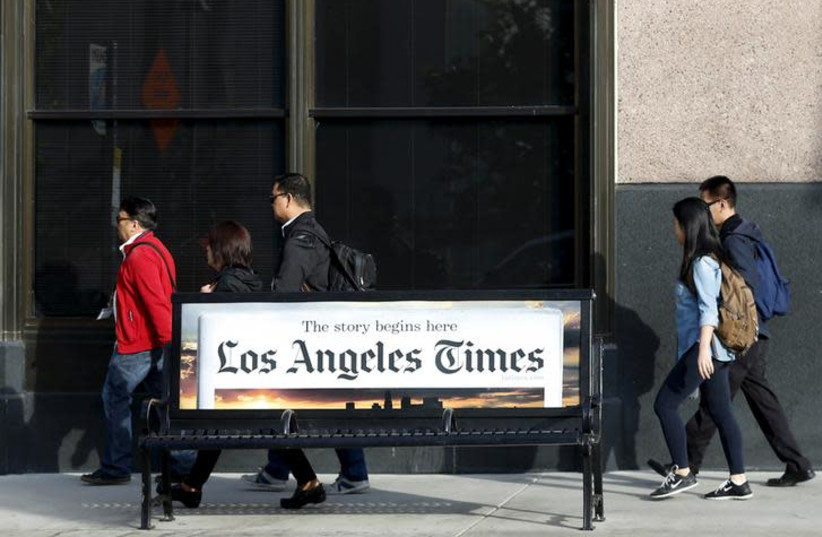 People walk past the building of Los Angeles Times newspaper, which is owned by Tribune Publishing Co, in Los Angeles, California, U.S. on April 27, 2016 (photo credit: REUTERS/LUCY NICHOLSON)
