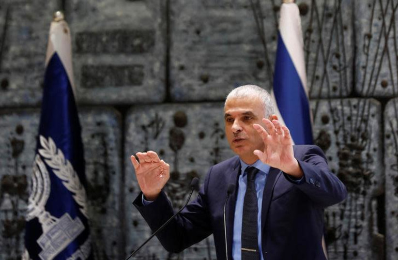 Finance Minister Moshe Kahlon speaks during a ceremony whereby Amir Yaron is sworn in as Bank of Israel governor by President Reuven Rivlin, in the presence of Prime Minister Benjamin Netanyahu, in Jerusalem December 24, 2018 (photo credit: AMIR COHEN/REUTERS)