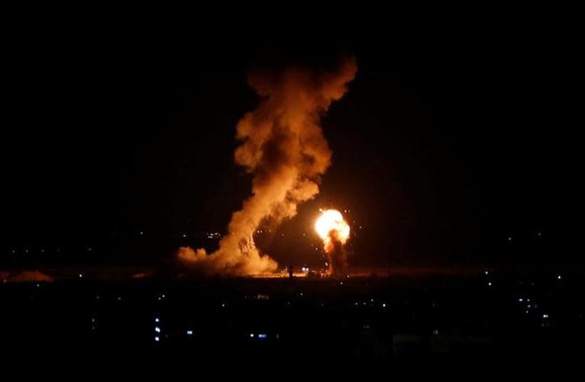 Smoke and flame are seen during an Israeli air strike in Gaza, November 12, 2018 (photo credit: AHMED ZAKOT / REUTERS)
