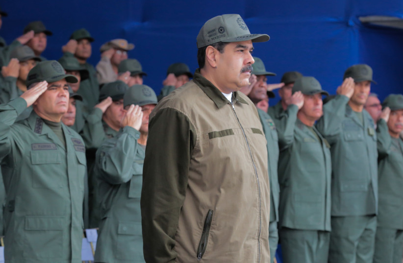 Venezuela's President Nicolas Maduro attends the end of the year ceremony with members of the Bolivarian National Armed Forces in Caracas, Venezuela December 28, 2018. Picture taken December 28, 2018. (photo credit: MIRAFLORES PALACE/HANDOUT VIA REUTERS)