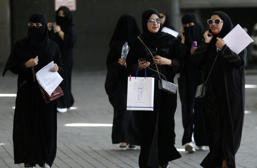 Saudi students walk at the exhibition to guide job seekers at Glowork Women's Career Fair in Riyadh, Saudi Arabia October 2, 2018 (photo credit: REUTERS/FAISAL AL NASSER)