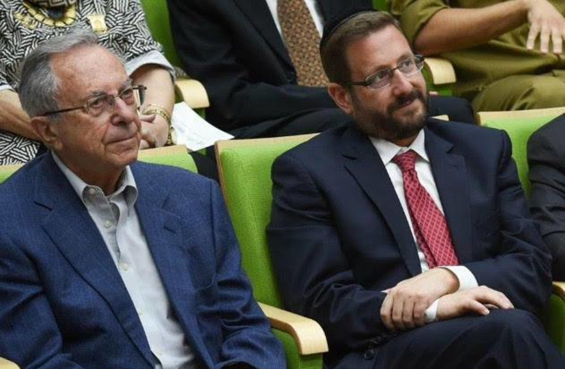 The late Moshe Arens [Left] next to former MK Dov Lipman [Right] at the Bonei Zion ceremony at the Knesset in which Arens was given a lifetime achievement award.   (photo credit: Courtesy)