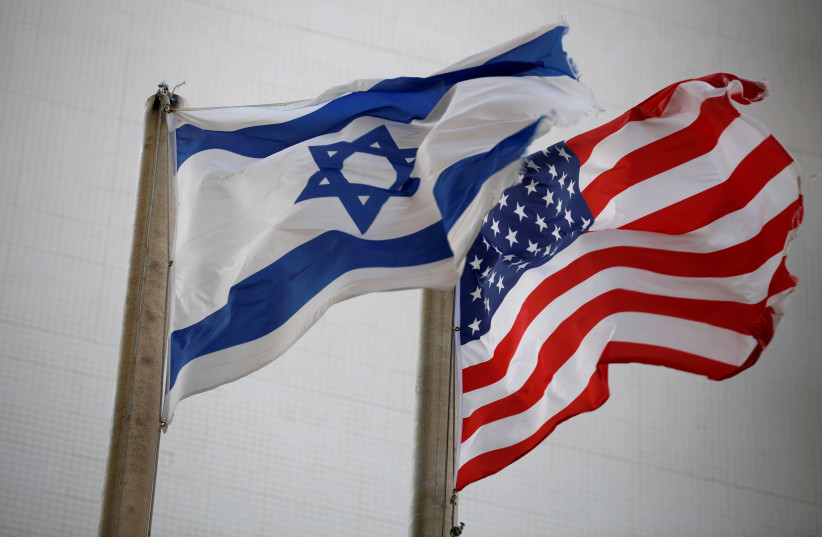 The American and the Israeli national flags can be seen outside the U.S Embassy in Tel Aviv (photo credit: AMIR COHEN/REUTERS)