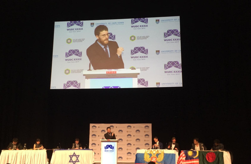 Israeli debate world championship Roy Shulmann makes a speech at the World Universities Debate Championship, 2019 (photo credit: DANA GREEN)