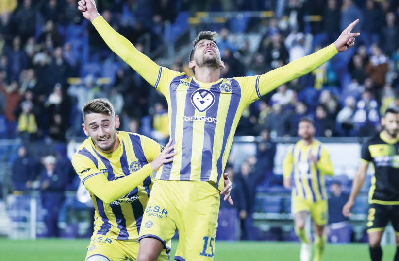 Maccabi Tel Aviv's Dor Micha (front) celebrates with teammate Omer Atzili after scoring the side's second goal in a 4-1 victory over Maccabi Netanya (photo credit: DANNY MAROM)