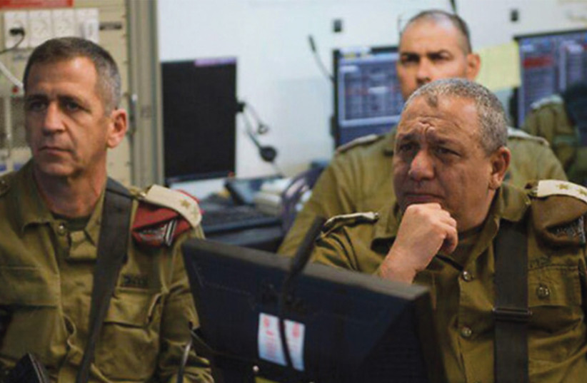 PASSING THE torch: Successor Aviv Kochavi (left) with Eisenkot. (photo credit: IDF)