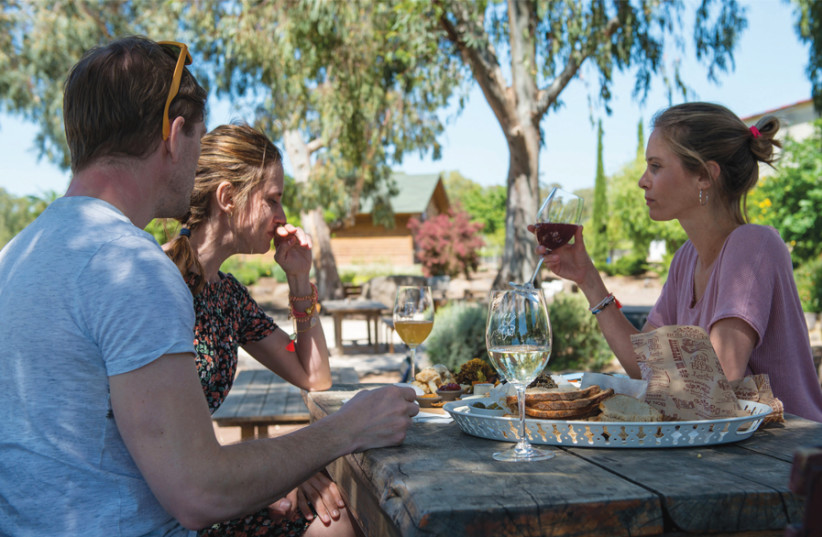GUESTS AND visitors enjoy homemade delights from the AdiKa Café. (photo credit: Courtesy)