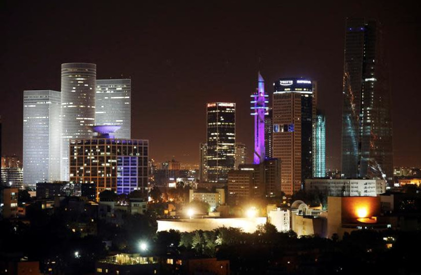 A cityscape of Tel Aviv is seen during the night-time in Israel May 27, 2017. Picture taken May 27, 2017. (photo credit: REUTERS/AMIR COHEN)