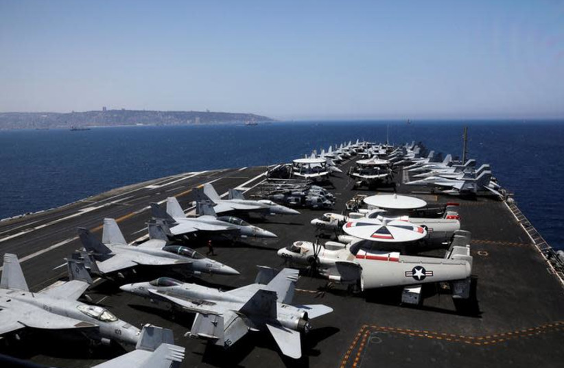 A general view shows the dock of the U.S. aircraft carrier USS George H. W. Bush, as it docks at Haifa port, Israel July 3, 2017 (photo credit: REUTERS/Ronen Zvulun)