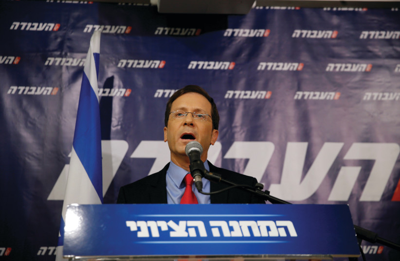 ISAAC HERZOG, former leader of Zionist Union, delivers a statement at the party headquarters in Tel Aviv, Israel, in 2016.  (photo credit: REUTERS/BAZ RATNER)