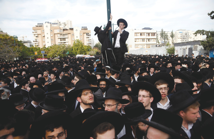 ULTRA-ORTHODOX Jews gather during a funeral ceremony in Bnei Brak. (photo credit: REUTERS/BAZ RATNER)