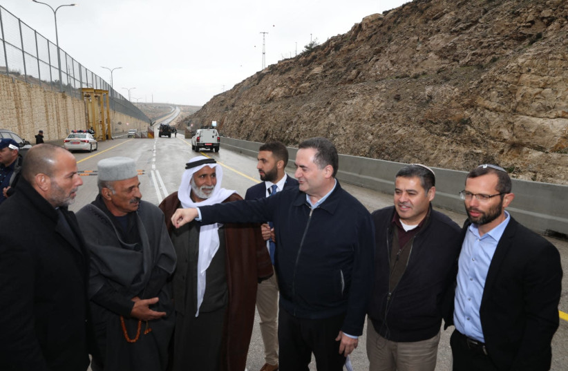 Israelis and Palestinians celebrate the opening of the road on Wednesday. Included in the photo is Transportation Minister Yisrael Katz and Binyamin Regional Council head Israel Ganz (photo credit: Courtesy)