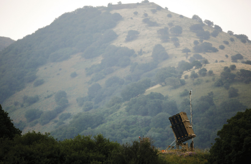 AN IRON DOME antimissile system is installed near the Israeli side of the border with Syria in the Golan Heights  (photo credit: AMIR COHEN/REUTERS)