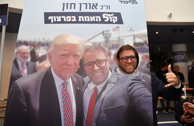 Oren Hazan posing with a poster of his selfie with US President Donald Trump at the Leumiada (photo credit: Lahav Harkov)