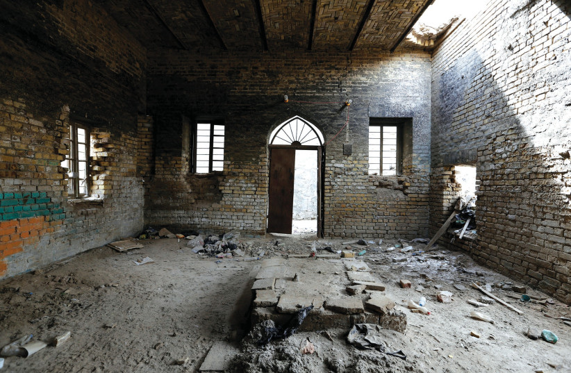THE INTERIOR remains of a synagogue are seen in the center of Baghdad (photo credit: WISSIM AL-OKILI/REUTERS)
