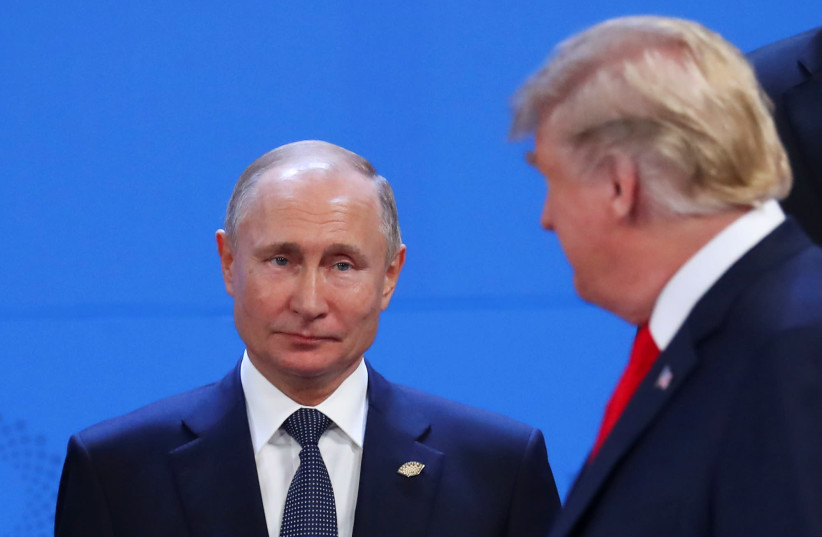 U.S. President Donald Trump and Russia's President Vladimir Putin are seen during the G20 leaders summit in Buenos Aires, Argentina November 30, 2018 (photo credit: MARCOS BRINDICCI/REUTERS)