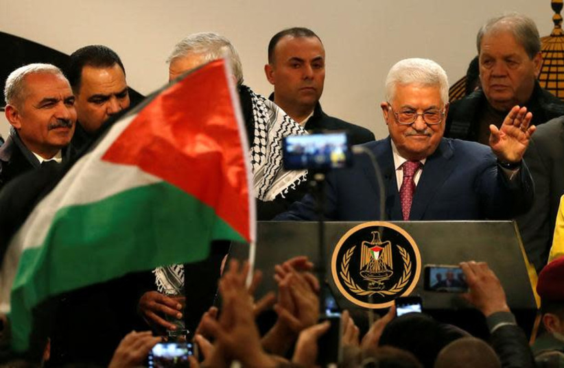 Palestinian Authority President Mahmoud Abbas gestures during a ceremony marking the 54th anniversary of Fatah's founding, in Ramallah, December 31, 2018 (photo credit: MOHAMAD TOROKMAN/REUTERS)